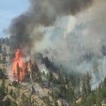 A fire burns near Holter Lake.