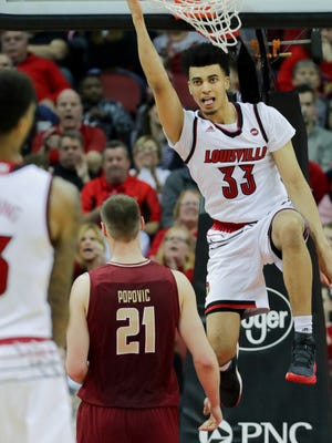 Louisville's Jordan Nwora dunks for two of his 15-points against Boston College.