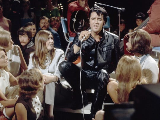 ELVIS: '68 COMEBACK SPECIAL -- Aired 12/3/68 -- Pictured: (center) Elvis Presley performs onstage in Burbank, Ca. as part of his '68 Comeback Special  (Photo by Gary Null/NBC/NBCU Photo Bank via Getty Images)