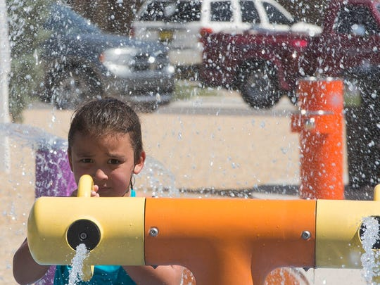 Aryanah Marlow,7 fires one of the water cannons at the Metro Verde Splash Pad, Thursday, June 15, 2017
