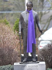 The James Buchanan statue the usually wears a scarf during the winter months, has a purple ribbon Thursday, March 17, 2016  in honor of the return of student Reese Burdette. Reese was severally injured in a fire and has spent the last two years at Johns Hopkins Medical Center in Baltimore.