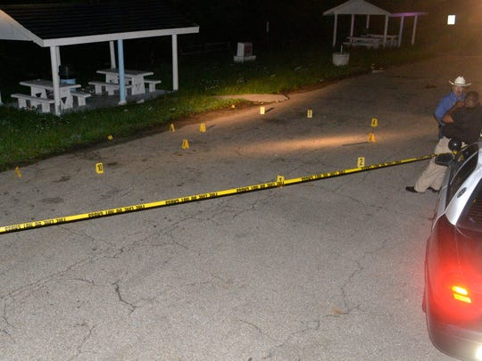 More than a dozen markers show where blood was spilled