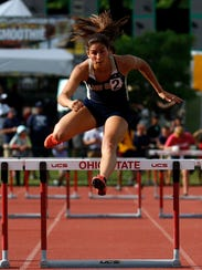 Lancaster's Hope Purcell runs in the 300 meter hurdles