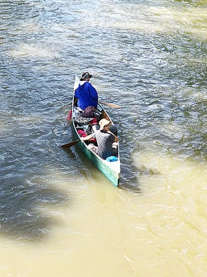 Nathan Lane, left, and Jevin McQuate paddled 160 miles from the Mohican River in Loudonville to the Ohio River in Marietta over a week in June.