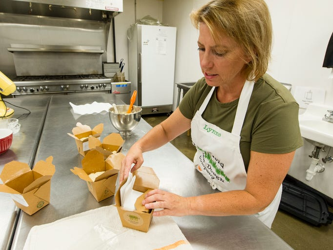 Lynne Driscoll, founder of Greenfield Cookie Dough Company, works in a commercial-grade kitchen at Indy's Kitchen, where she produces her cookie dough, packaging it in one-pound packages to make 36 cookies.