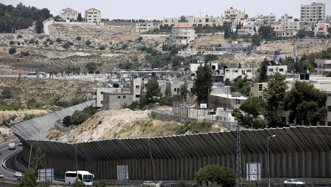 Parts of the Israeli separation wall near the West Bank city of Bethlehem.