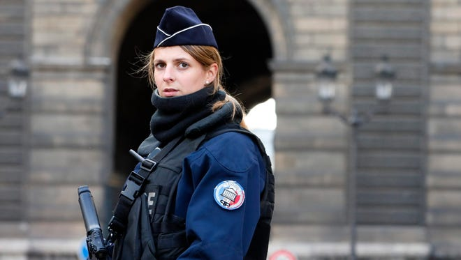 A police officer stands guard near the Carrousel du Louvre where a French soldier opened fire after an attempted machete attack by a man allegedly shouting 'Allahu akbar', in Paris, Feb. 3, 2017.