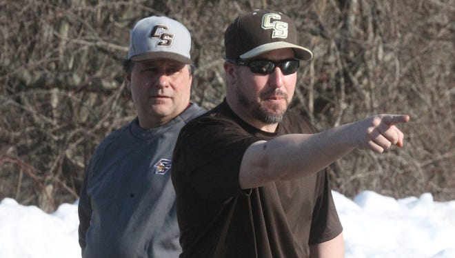 Clarkstown South baseball co-coaches Tom Lynch, left, and Mike Amendola work with their team in a parking lot at the school March 11, 2014.