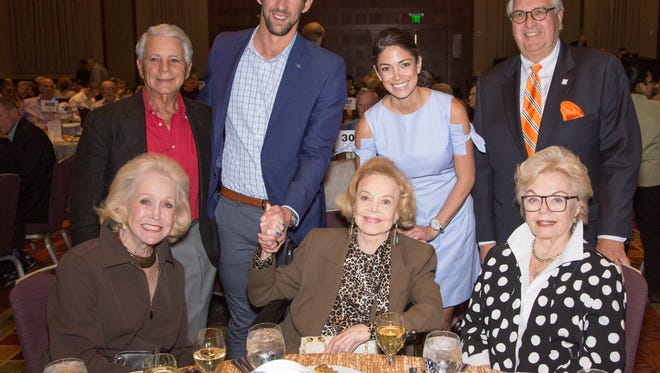 From left, standing:  Board of Director Arthur Jacobson, Michael and Nicole Phelps, CEO/Executive Director John Thoresen.  Seated, from left:  Board of Director Nelda Linsk, Founder/Chairwoman Barbara Sinatra, Rita Vale.