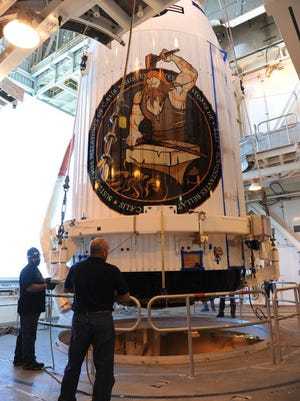 The NROL-55 payload, encapsulated in a 4-meter diameter payload fairing, was mated to an Atlas V booster inside the Mobile Service Tower, or MST, at Vandenberg Air Force Base's Space Launch Complex-3.
