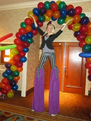Stilt Walker Courtney Young was among those helping  carry out the Feist-Weiller Life Savers'  circus theme.