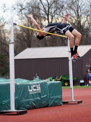 Finishing up a practice jump is Plymouth senior Nathan