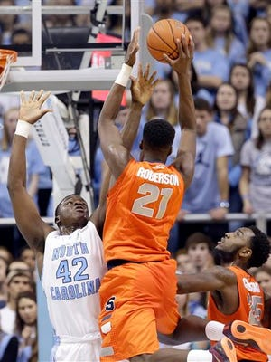 North Carolina's Joel James (42) defends against Syracuse's Tyler Roberson (21) during the first half of an NCAA college basketball game in Chapel Hill Monday. North Carolina took the win, 93-83.