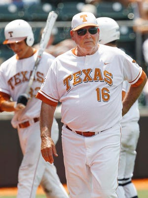 In this June 6, 2011, file photo, Texas' coach Augie Garrido (16) is shown during the fifth inning of an NCAA Regional college baseball game against Kent State, in Austin, Texas. Garrido, the winningest coach in college baseball history, is out after 20 seasons at Texas.