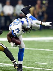 Detroit Lions running back Theo Riddick (25) is tripped