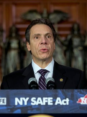 New York Gov. Andrew Cuomo speaks in January 2013 after signing New York's Secure Ammunition and Firearms Enforcement Act, or SAFE Act, into law.