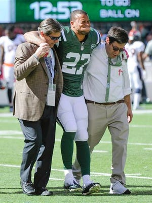 In this Oct. 12, 2014, file photo, New York Jets cornerback Dee Milliner is helped off the field with an ankle injury during a game against the Denver Broncos.