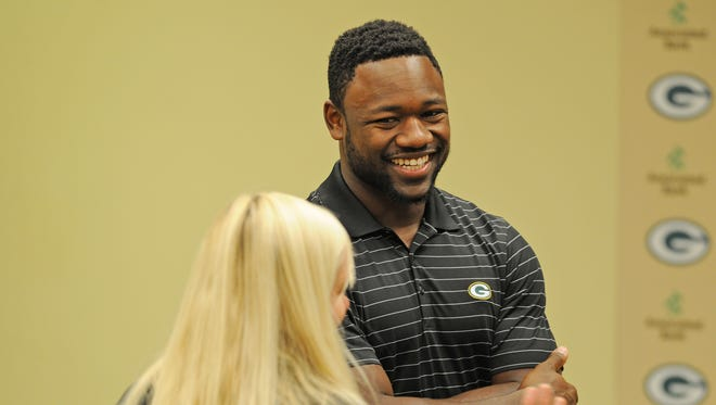Green Bay Packers wide receiver Ty Montgomery talks about domestic violence during a meeting at Lambeau Field to announce a cellphone collection program to help victims of domestic violence.