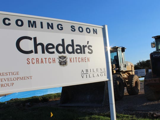 A sign placed near heavy construction equipment announces in October 2017 that a Cheddar's Scratch Kitchen will be built at The Shops at Abilene Village in southwest Abilene. It will open April 1l.