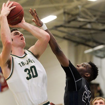 West High's Connor McCaffery draws a foul from Pleasant