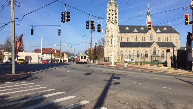 Warsaw, St. Lawrence and Enright Avenues converge at St. Lawrence Catholic Church in the Cincinnati neighborhood of East Price Hill.