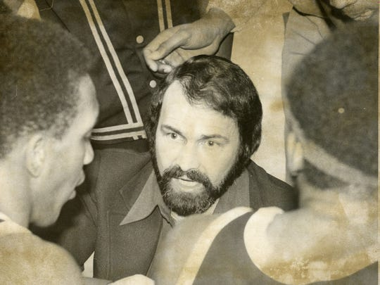 Asbury Park coach Nate Bruno talks to his players during a timeout in a 1978 state tournament game, with the Blue Bishops going on to win their first state championship since 1943.