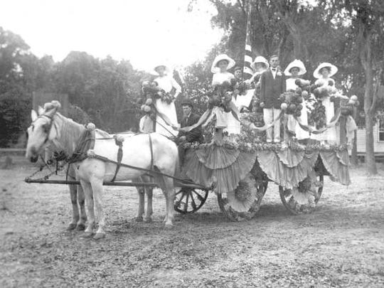 Seniors of the Gwynne Institute are shown with their class float. One year after it was built, Fort Myers outgrew the new school.