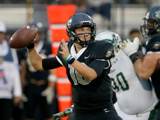 UCF Knights quarterback McKenzie Milton (10) looks to throw a pass during the second quarter against the South Florida Bulls at Spectrum Stadium. Mandatory Credit: Reinhold Matay-USA TODAY Sports