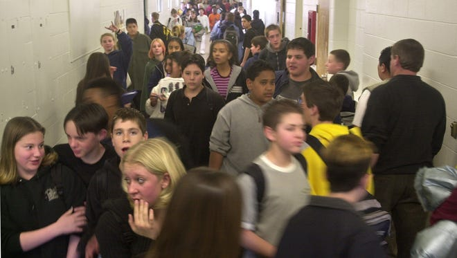 Students at Sparks Middle School crowd the hallways during a class change.