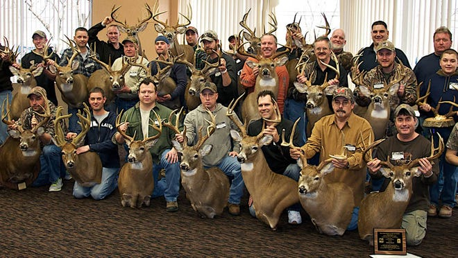 Deer hunters show off trophy heads at