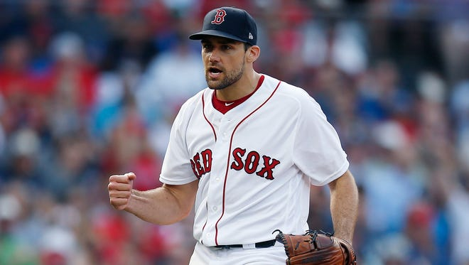 Boston Red Sox's Nathan Eovaldi reacts after striking out New York Yankees' Gleyber Torres to retire the side during the seventh inning of a baseball game in Boston, Saturday, Aug. 4, 2018.