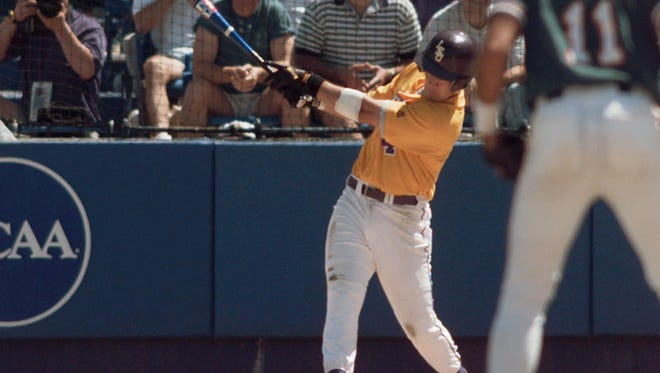 Louisiana State's Warren Morris follows through on his game winning two-run home run against Miami in the bottom of the ninth at the College World Series in Omaha, Neb., Saturday, June 8, 1996. LSU won the national championship 9-8. (AP Photo/Rodney White)