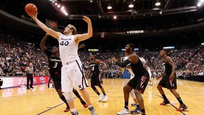 Xavier center Matt Stainbrook rebounds against the UC Bearcats on Dec. 14, 2013.