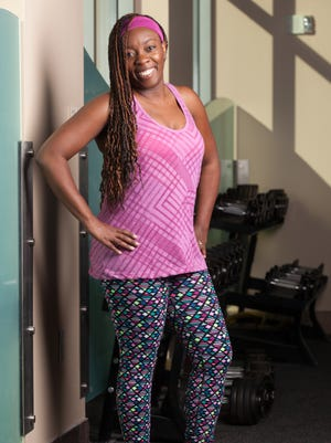 Erica Sewell works out with her husband, Kennis, a personal trainer and fitness instructor.