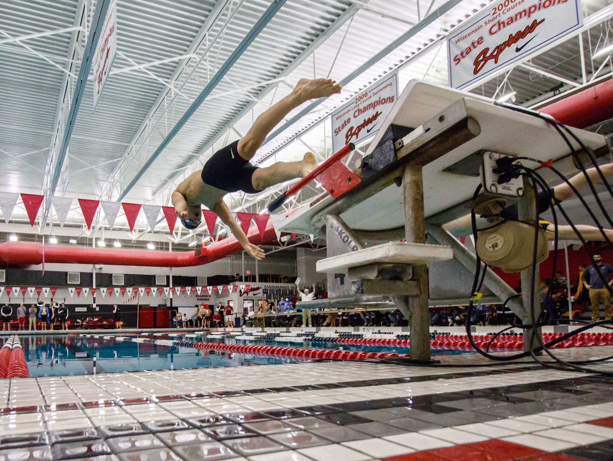 Competitors launch off the blocks during the 2018 WIAA