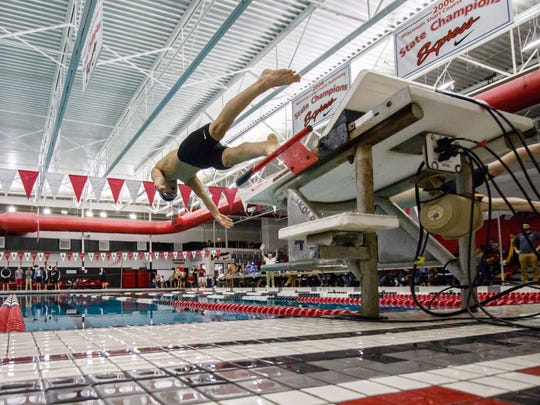 Competitors launch off the blocks during the 2018 WIAA Division 1 Boys Swimming and Diving Sectional at Waukesha South on Saturday, Feb. 10.
