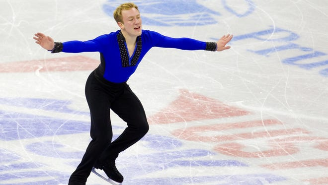 In a file photo from Jan. 25, 2013, Ross Miner during the senior men's short program of the U.S. Figure Skating Championships in Omaha.