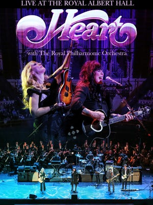 """""""I loved the girls' voices and the sense of mystery they conveyed,"""" Dan Rothchild says about Ann and Nancy Wilson of Heart. Pictured: Heart and  Rothchild in concert."""