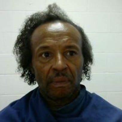 John McKnight, 54, 5-feet-3, 170 pounds, black hair,