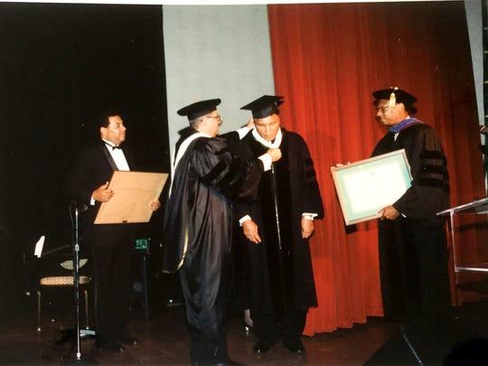 Then FAMU Provost James Ammons, (far right) prepares