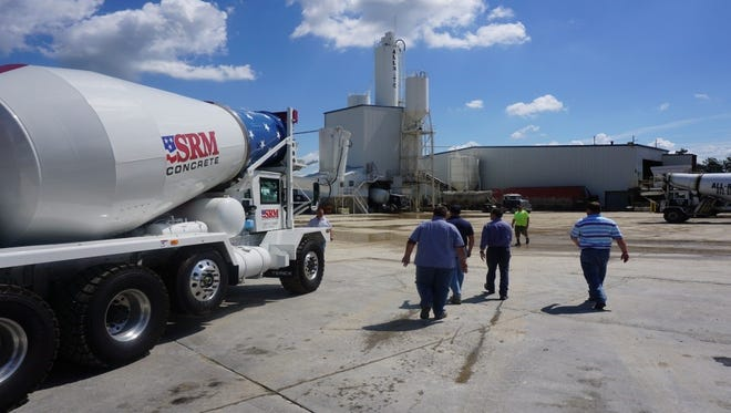 CEO of Smyrna Ready Mix Concrete, Jeff Hollingshead, third from left, meets with employees at the Florence, Ky.-based company All-Rite Ready Mix.