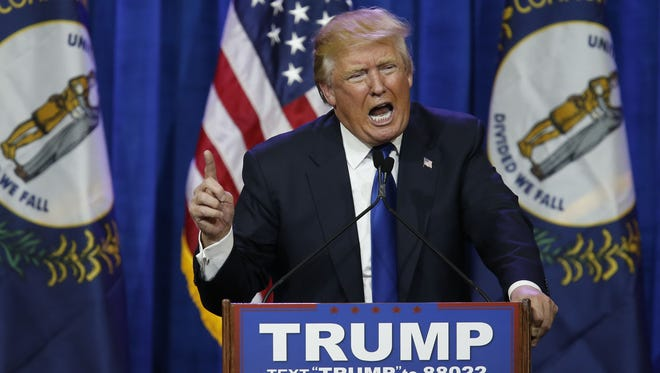 Pat McDonogh/The CJ U.S. Sen. Rand Paul said GOP Presidential candidate Donald Trump seeks too much power for the office. Republican Presidential candidate Donald Trump made a point during a Super Tuesday rally in Louisville. March 1, 2016.