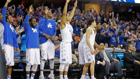 The Kentucky Wildcats bench reacts to a made 3-point