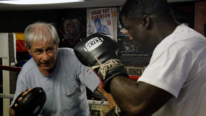 Naples' Freeman Barr, who will be inducted into the Florida Boxing Hall of Fame on June 24, works out with longtime trainer and promoter Steve Canton at SJC Boxing in Fort Myers on Tuesday, June 22, 2016.