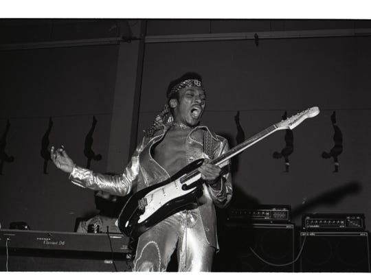 Ernie Isley of the Isley Brothers plays guitar, circa