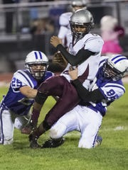 Shippensburg's Adam Houser (8) is brought down by Northern