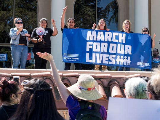 Local students Adrienne Carcha-Diaz, left, Ruth Sosa, Genesis Paniagua, Genesis Gonzalez, Destiny Campos, Brianna Luna and Sloane Vanciel were the key organizers for the March For Our Lives in Visalia on Saturday, March 24, 2018. Hundreds gathered at College of the Sequoias before marching along Mooney Blvd. to bring awareness to gun violence. Two groups, March For Our Lives and Cesar Chavez Legacy March, walked together as far as Redwood High School where both paused for a moment of silence and speeches.
