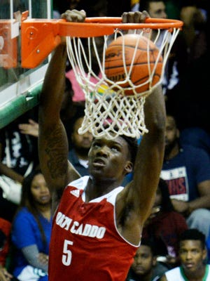 North Caddo's Robert Williams dunks the ball during a win over Bossier earlier this season.