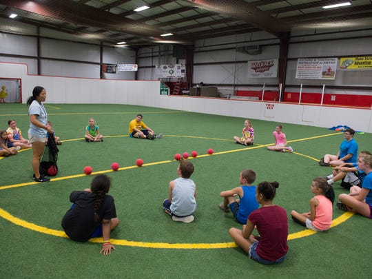 Metro Sports Center counselor Marissa Klein, left, lays down the rules for dodgeball to the Camp Gilda 2017 campers Tuesday morning.