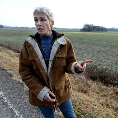 Anne Goetze stands along Coleman Road on Wednesday,